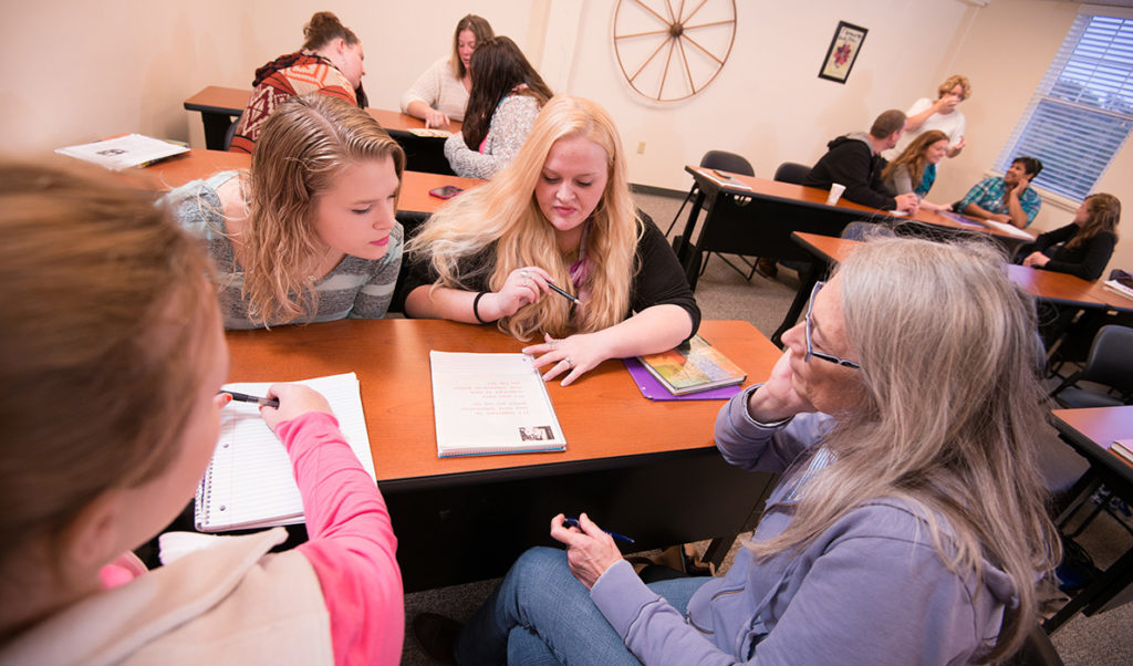"""Students at Rockland's """"URock"""" work with an instructor."""