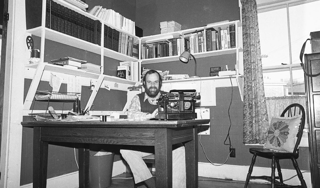 Island Ad-Vantages publisher and editor Nat Barrows at his typewriter in the early years.