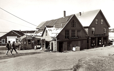 An image from the 1960s or 1970s, with the Monhegan Boat Lines office seen at left.