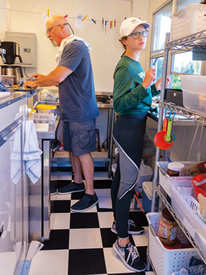 Gary and Meri Rainford work in the kitchen.
