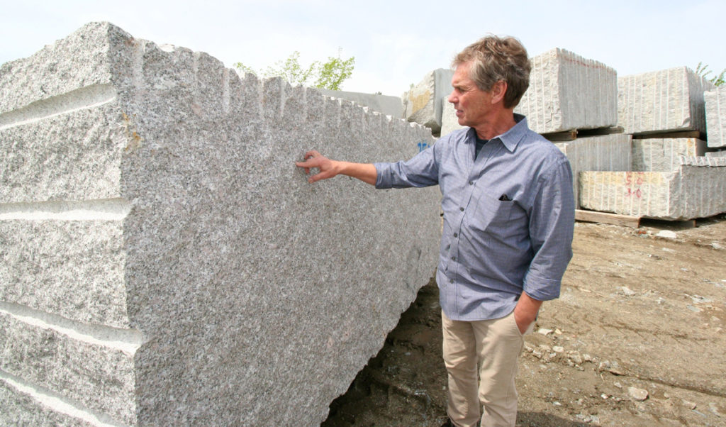 Jeff Gammelin points out the qualities of the granite.