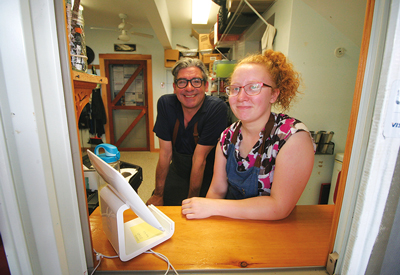 Hitty's Café owner Cezar Ferreira with employee Amber Walls.