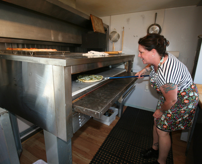 Emily Damon opened Island Takeaway in Town Hill as an affordable location to prepare her gourmet pizza and other items.