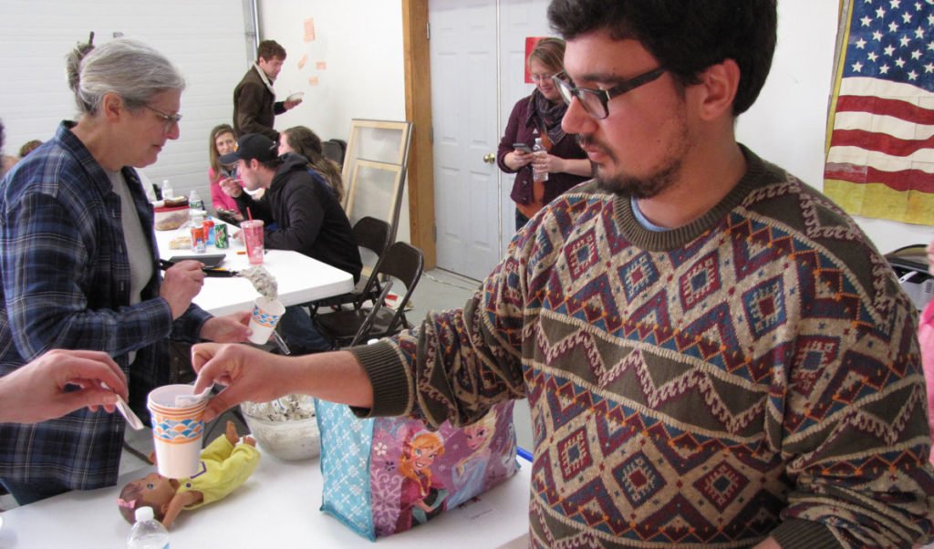 Zain Padamsee collects ballots at a recent chili cook-off event on Frenchboro.