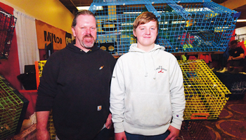 Philip Donovan, left, with his son Harley.