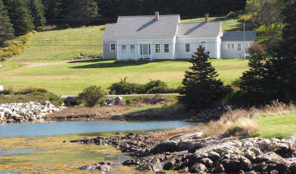 An older Cape Cod house on Isle au Haut's shore.