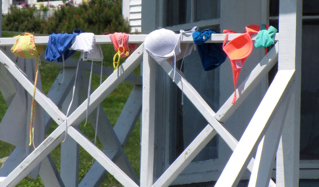 Bathing suits of the modest variety dry in the sun on Peaks Island.