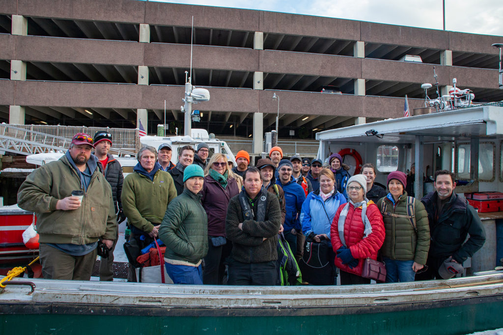 Participants in the Island Institute's Aquaculture Business Development (ABD) program join Institute staff and other guests on the boat prior to the start of the morning farm tours during the 2019 Industry Day event on December 5th in Portland.