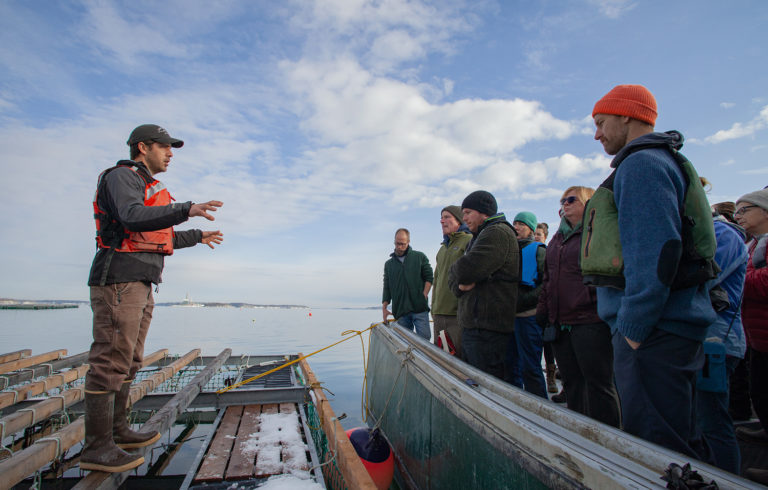 Matt Moretti (left) from Bangs Island Mussels takes ABD participants on a tour of his farm operations during the group's annual Industry Day event in December.