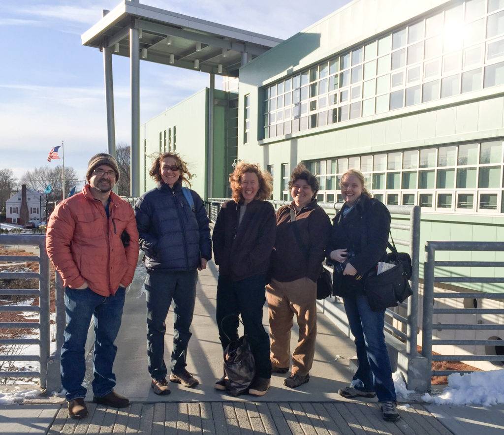 The group in front of the Marine Science Magnet High School of Southeastern CT in Groton