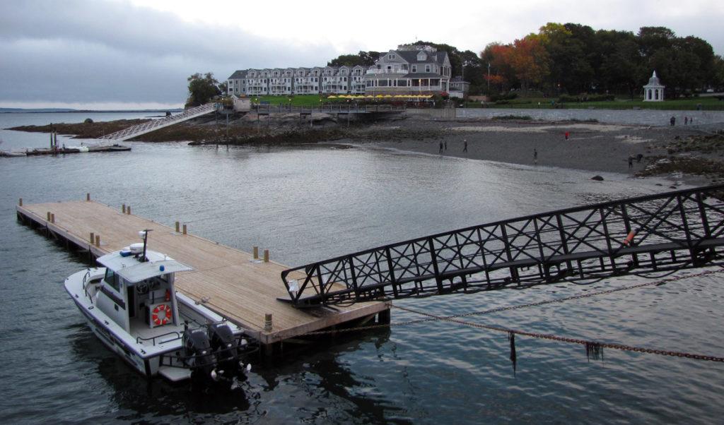 The Bar Harbor Inn at center on a cloudy autumn day.