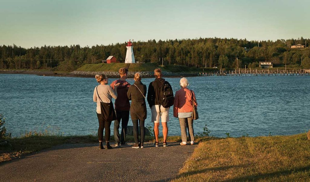 Visitors to Lubec look across the narrows that connects Cobscook Bay with the Atlantic Ocean and marks the international border. Mulholland Light is on Campobello Island in Canada.