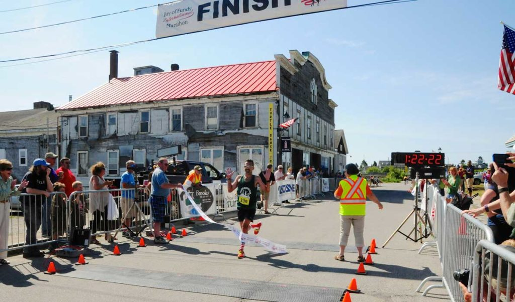 A runner crosses the finish line in Lubec.