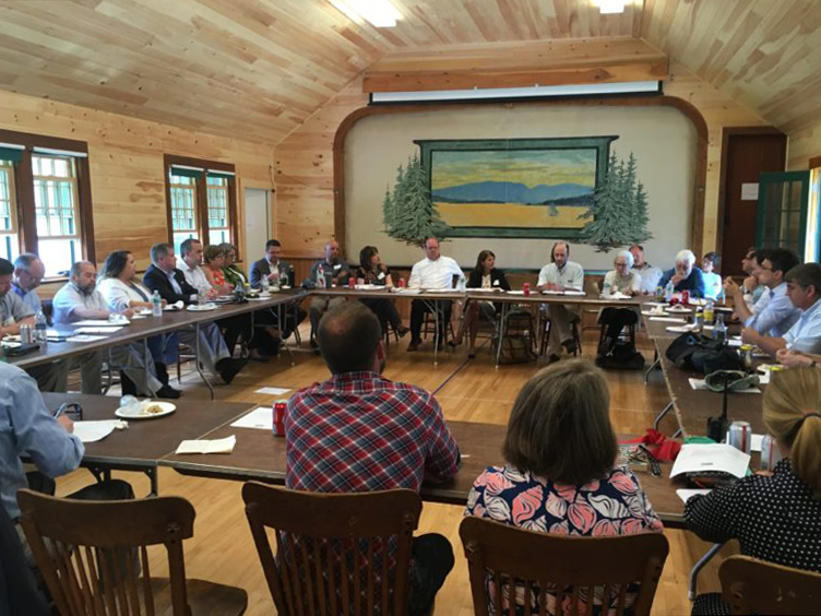 State and community leaders take part in a roundtable discussion on broadband in Maine following the ribbon cutting on the Cranberry Isles in July.