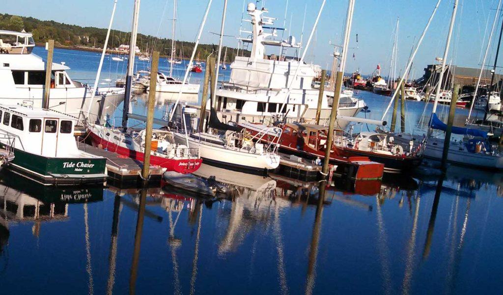 The late afternoon sun illuminates boats in Front Street Shipyard's marina on Belfast Harbor.