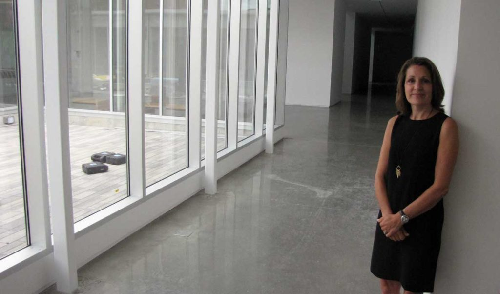 Suzette McAvoy in a hallway at the new Center for Maine Contemporary Art.
