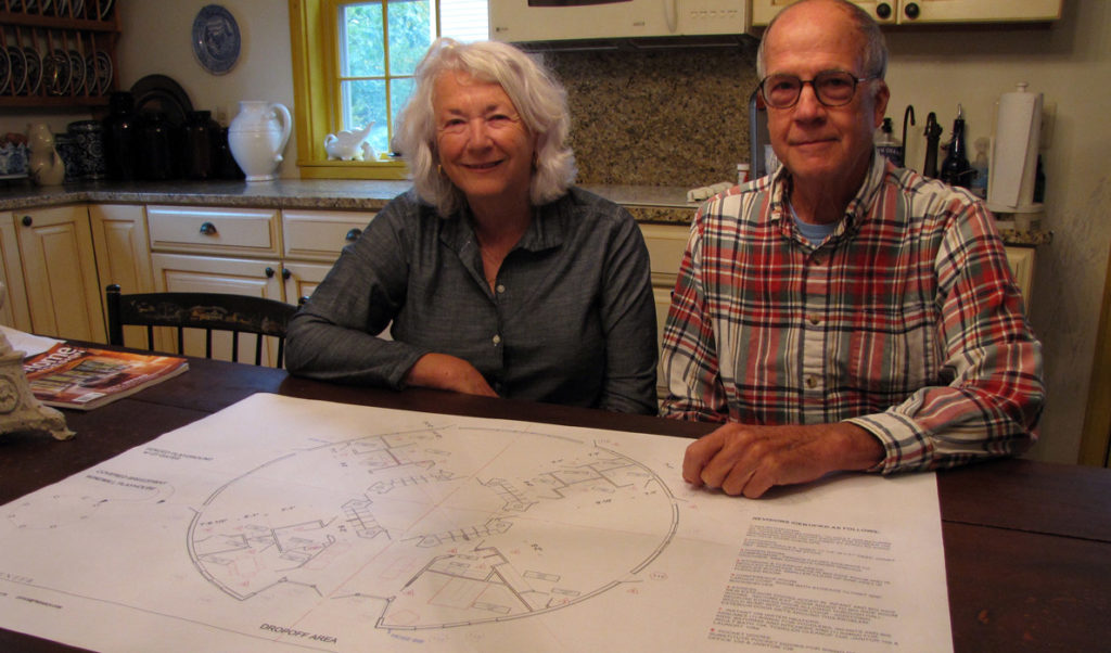 Nancy and W.G. Sayre with blueprints for the new childcare center.