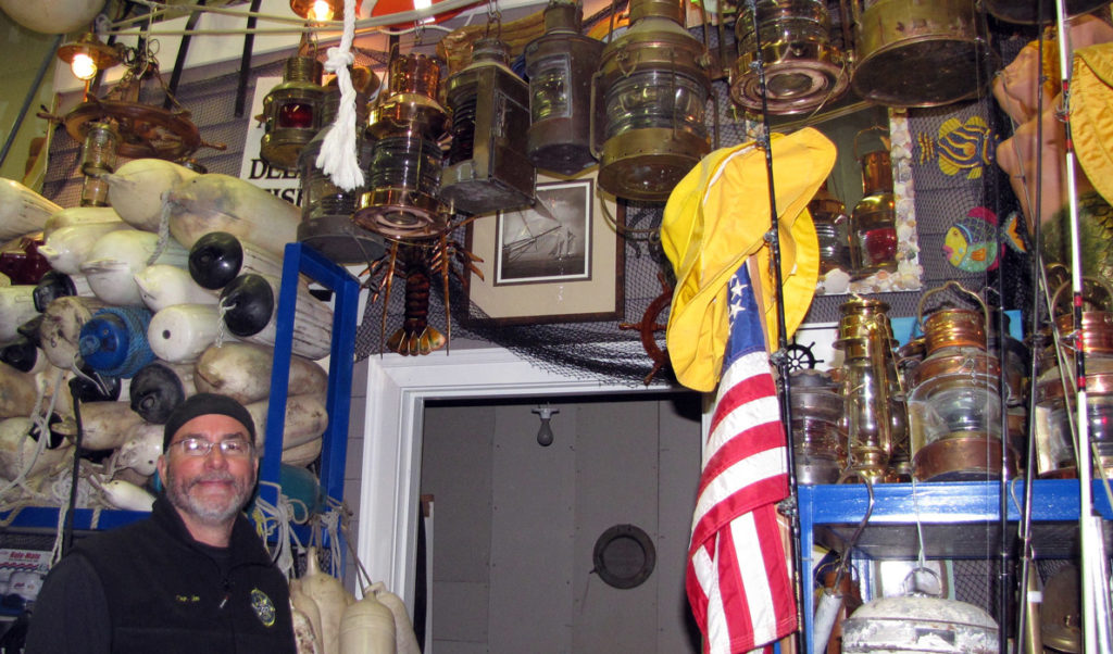 Jim Harkins among his store of nautical gear.
