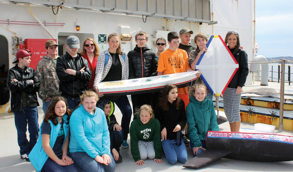 Swan's Island students on the deck of the State of Maine with their boat