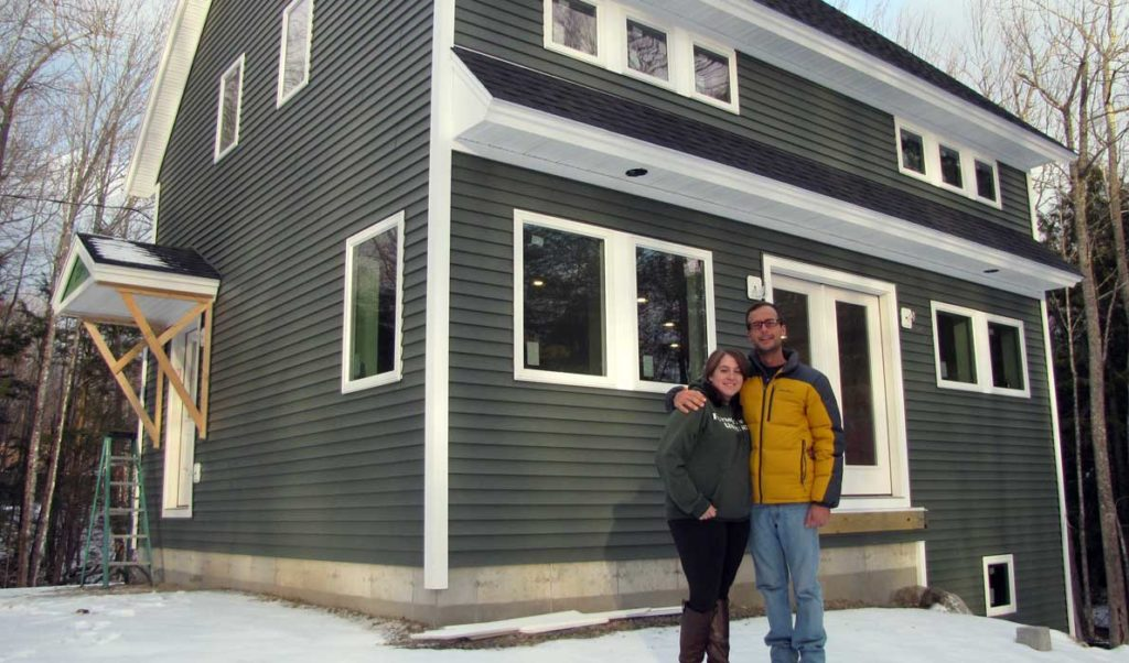 Megan and Keaton Scarponi in front of their soon-to-be-completed new house in Washington.