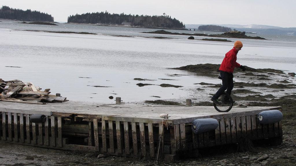 Ryan Murphy unicycles at the Dark Harbor Boat Yard on Islesboro.