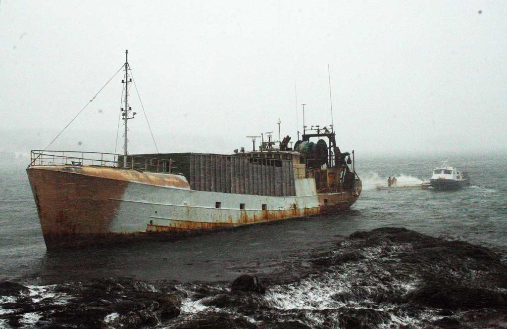 The fishing vessel Westward being towed off a ledge by Fuller Marine Services in  Boothbay Harbor on Jan. 9.