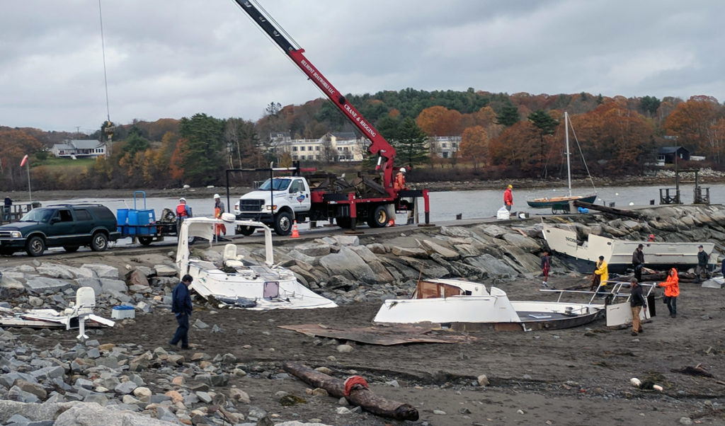 The remnants of boats destroyed during the Oct. 30 storm washed ashore near Belfast's breakwater.