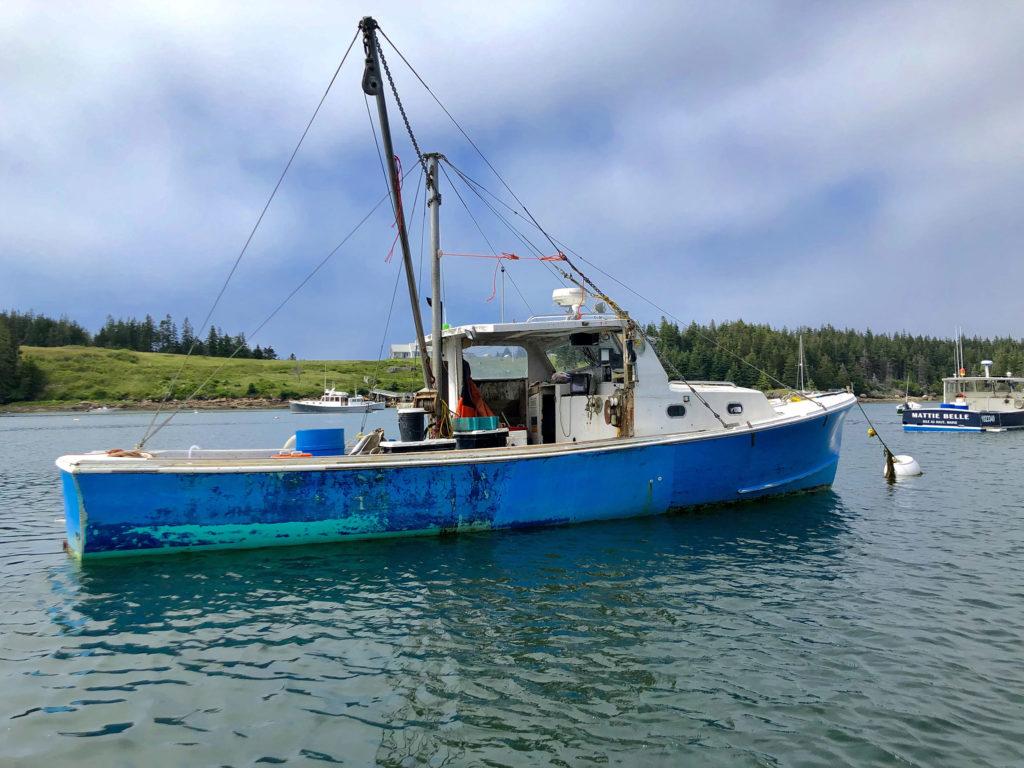 A boat docked in Isle au Haut.