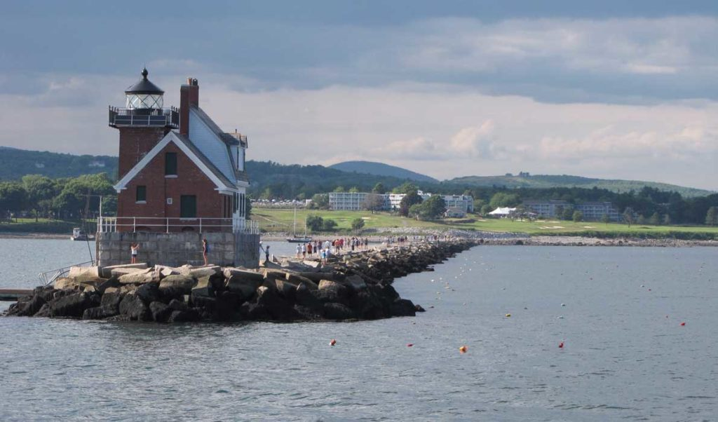 Tourists enjoy a stroll on Rockland's breakwater in late July.