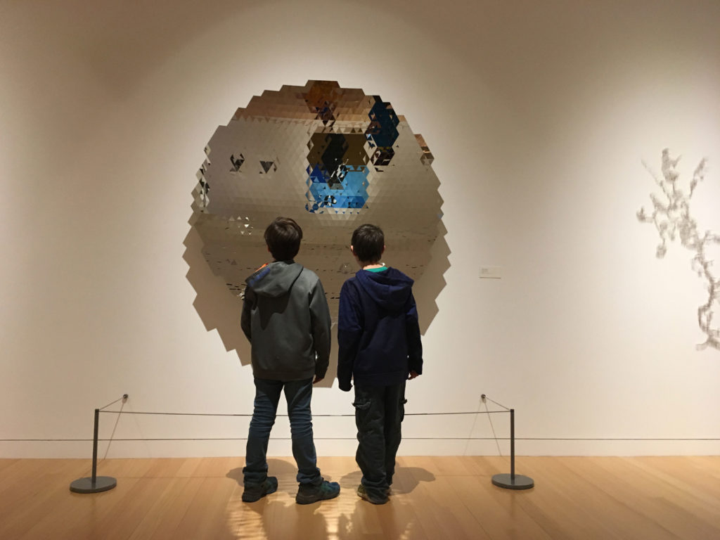 TLC students check out one of the pieces inside the art museum at Colby College during the spring TLC field trip.
