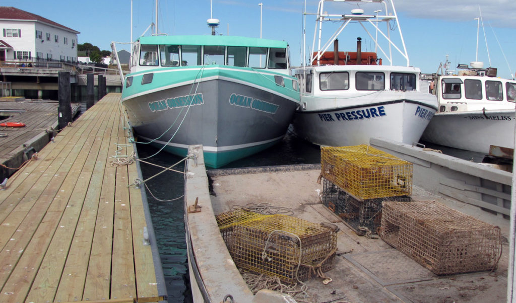 Lobster boats docked inside Eastport's breakwater. Lobstermen throughout Maine now face a trade hurdle their Canadian counterparts do not.