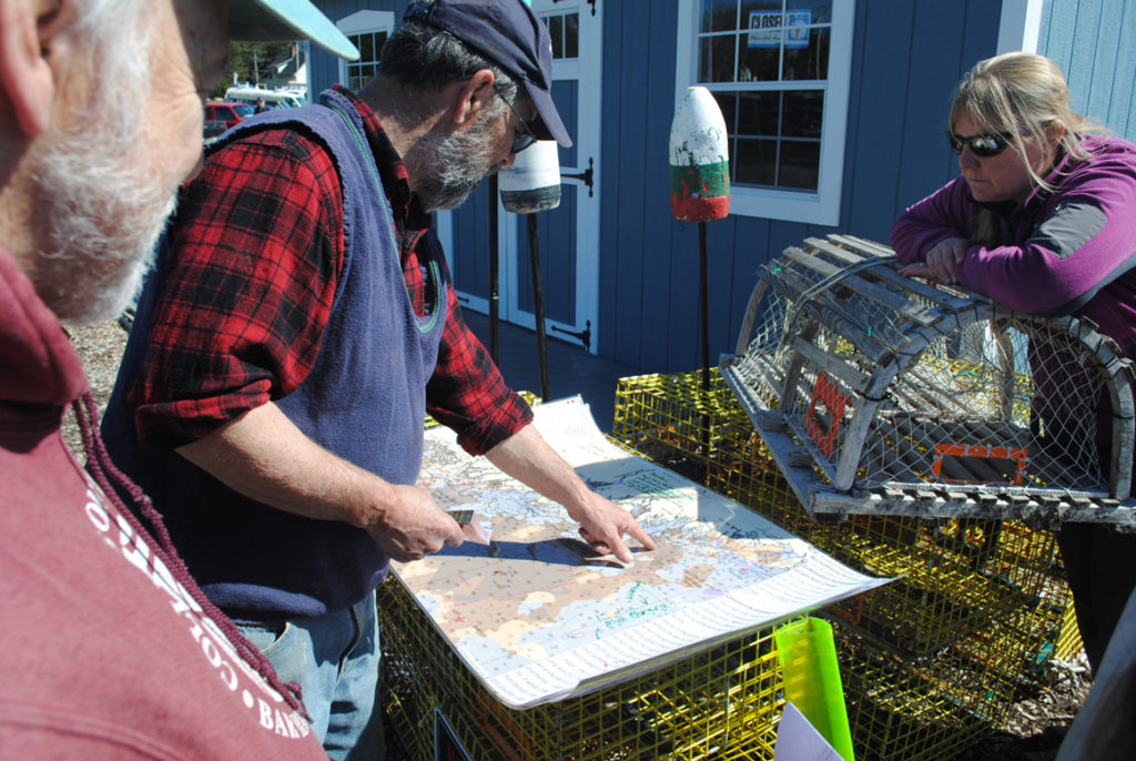 Dave Thomas looks at a map we created with data from the Northeast Ocean Data Portal. He explained that lobster are now found on bottom types that used to be unproductive.