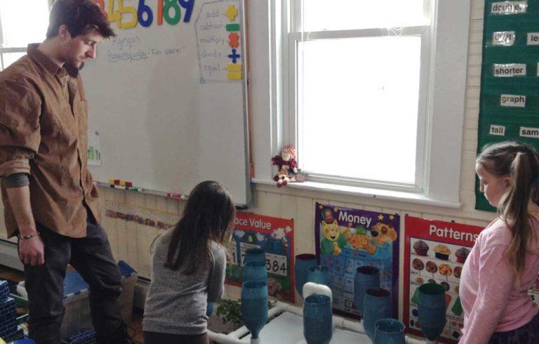 Lucas Milardo works with Frenchboro's two students.