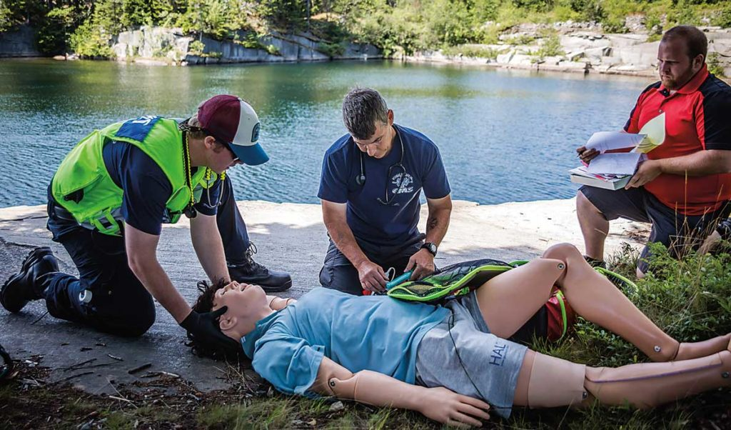 Emergency response volunteers practice with a mannequin on Vinalhaven.