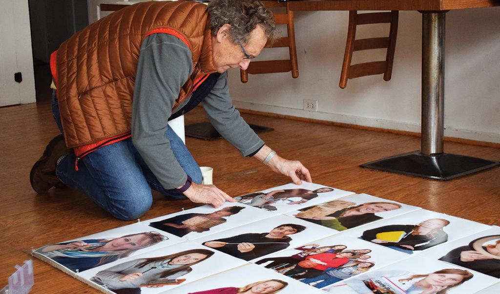 Richard Howard examining his photos of Vinalhaven residents.
