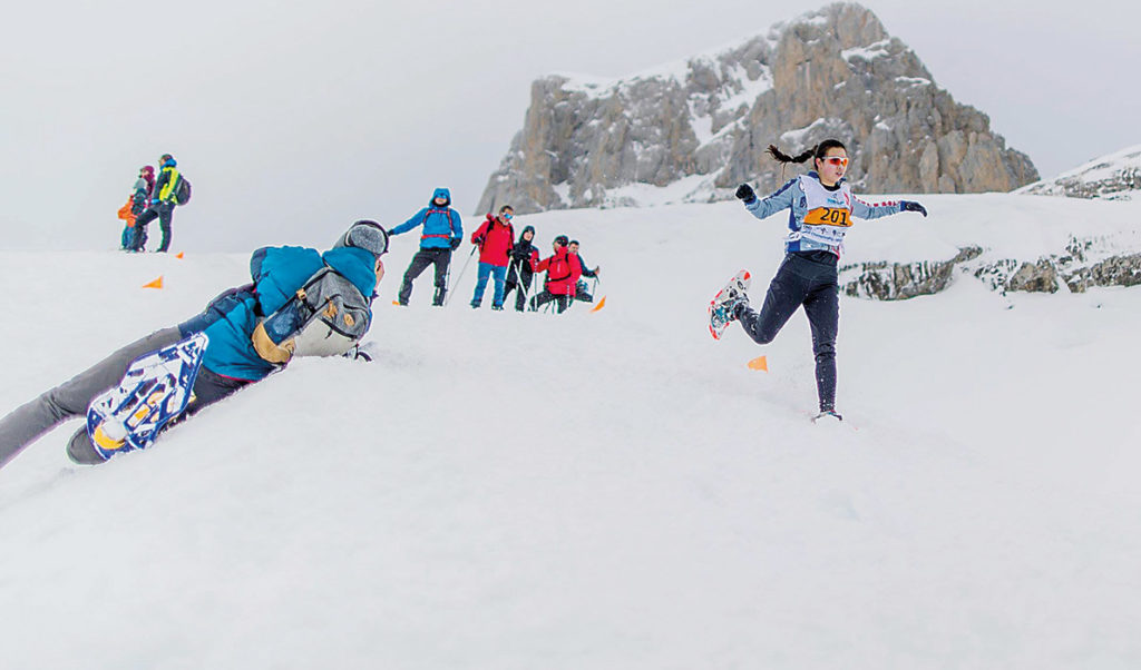 Rogers competing at snowshoe running.