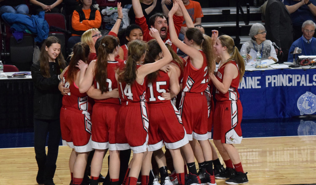 The Vinalhaven Vikings girls basketball team celebrates its Class D state championship in Bangor on Friday