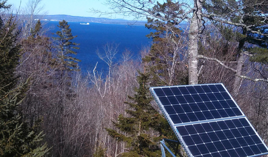 A photovoltaic panel in a yard on Islesboro.