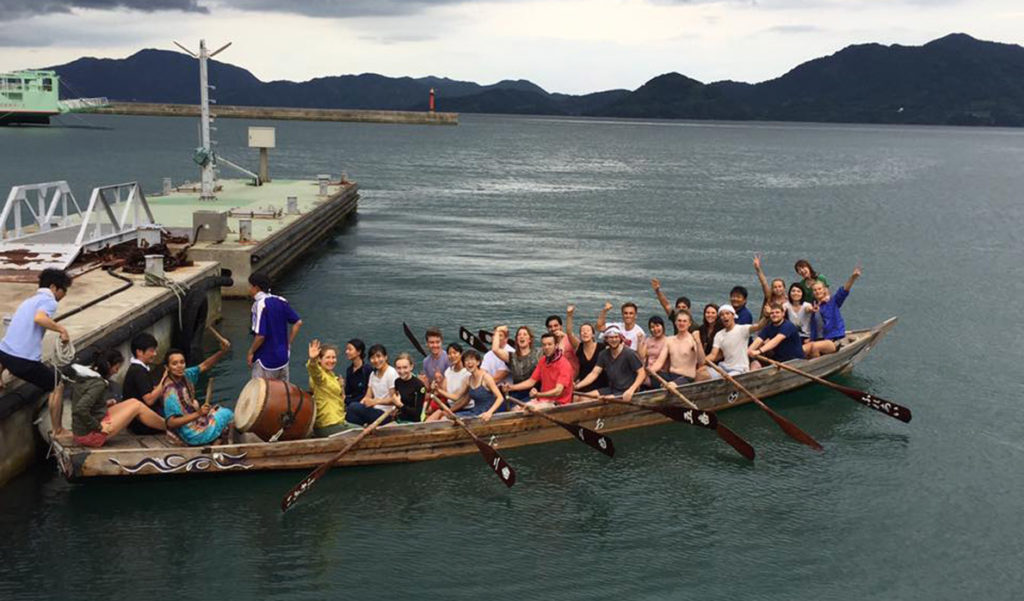 "The HELIO group tries rowing a local ""dragon"" boat."