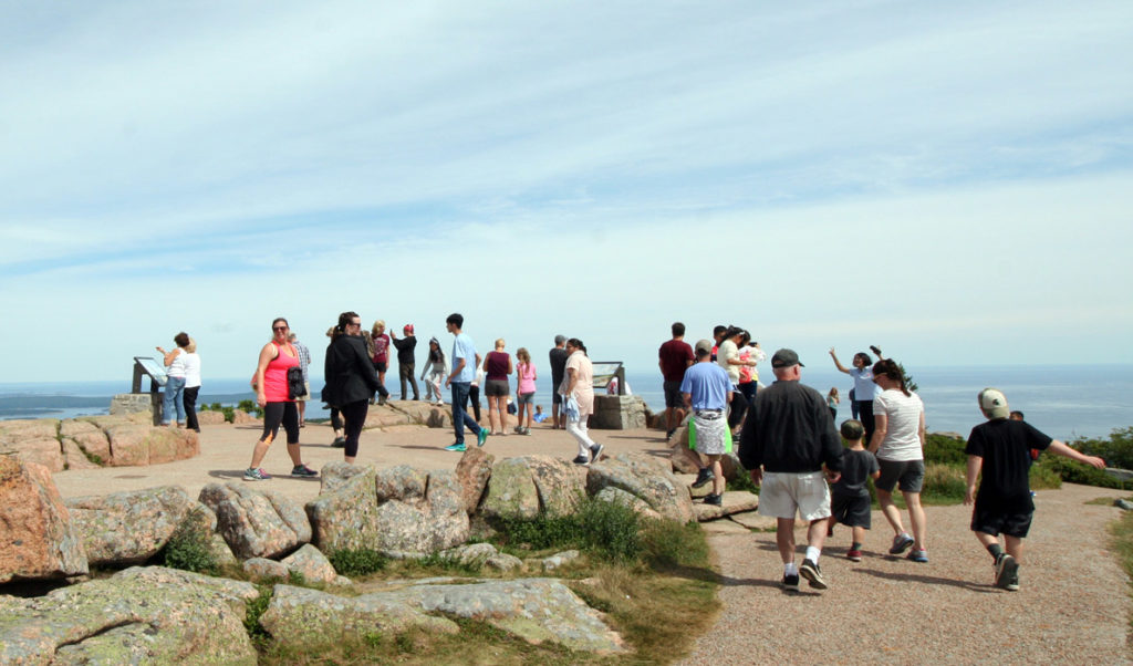 Visitors flock to the top of Cadillac Mountain in Acadia National Park