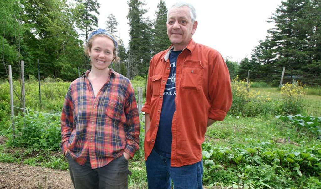 Landowner Mark Alley and Island Institute Fellow Jessi Duma at the garden Alley is allowing Duma and her colleagues to bring back after a long period of lying fallow.