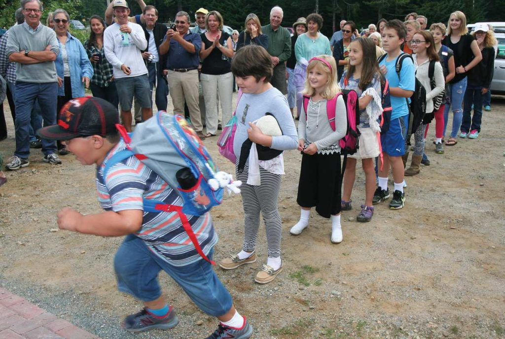 Students line up to enter the Longfellow school on Great Cranberry Island. The school reopened on Sept. 1.