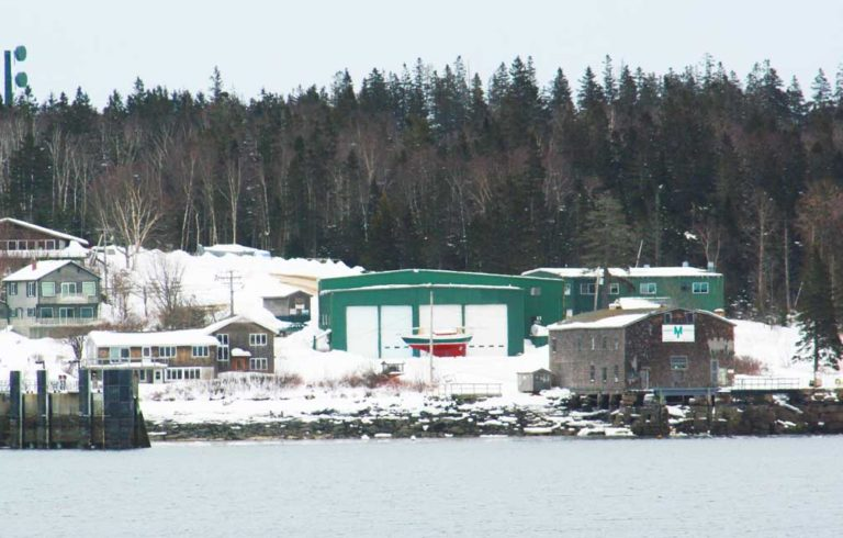The Morris Yachts yard in Bass Harbor is up for sale. The old Sim Davis building is on the right.