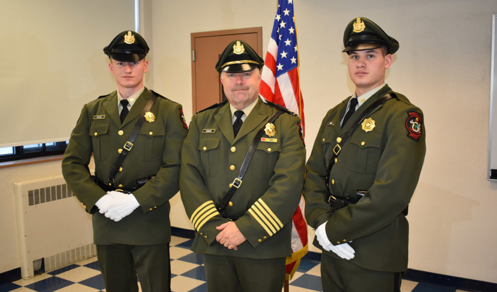 Marine patrol officers Jonathan Varnum (left) and Alex Hebert (right) pose with Col. Jonathan Cornish after graduating from the Maine Criminal Justice Academy on Dec. 15. Having previously completed the academy's pre-service program