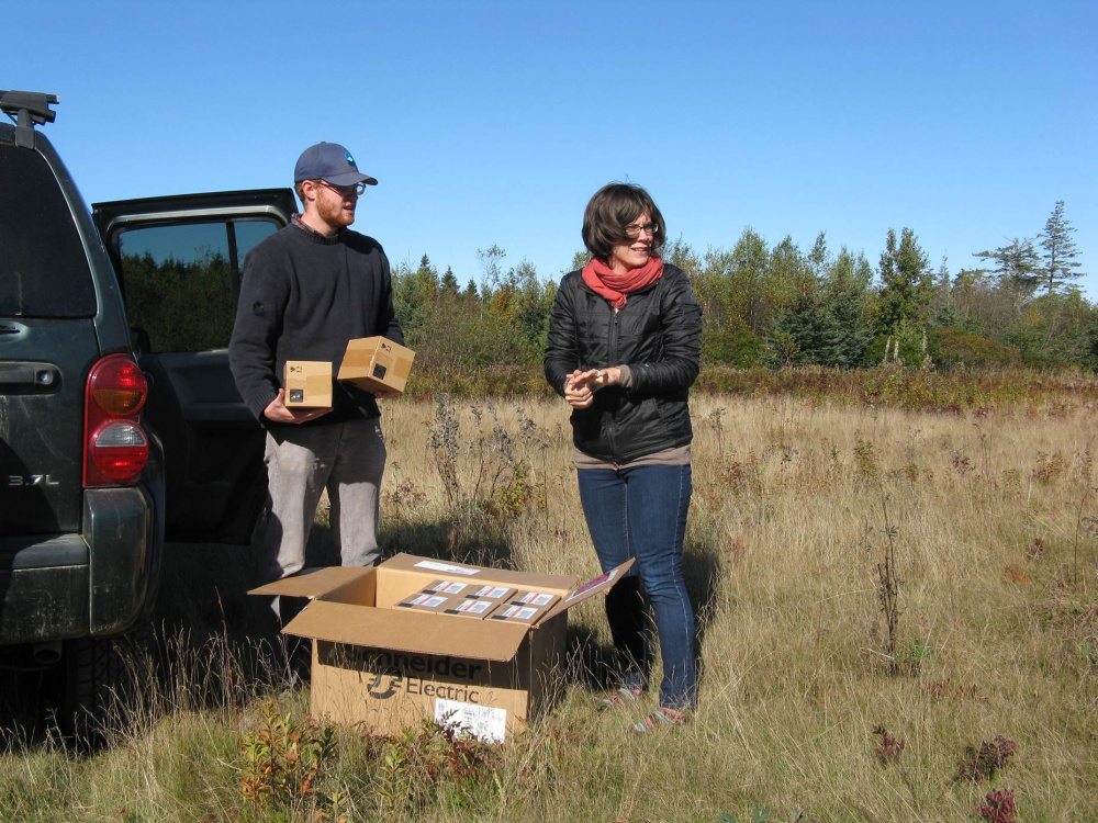 Ben Algeo and Suzanne MacDonald unload boxes of LEDs