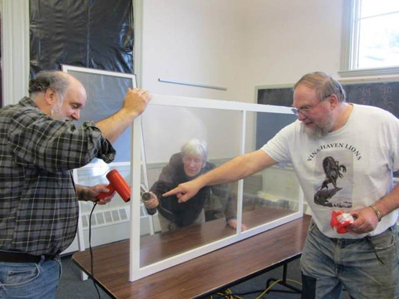 KK and other team members build interior storm windows