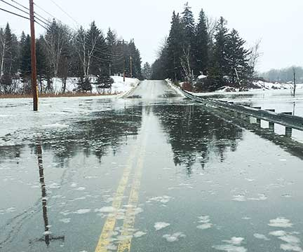 This road on Vinalhaven floods more than a dozen times a year (shown here during a high tide on Feb. 21