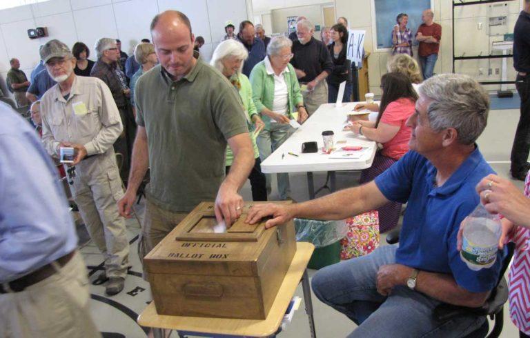 Jon Bolduc votes at Islesboro's annual town meeting on Saturday