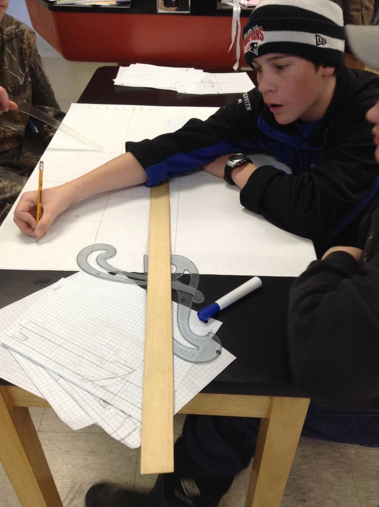 Students at Deer Isle-Stonington High School design lobster boats.