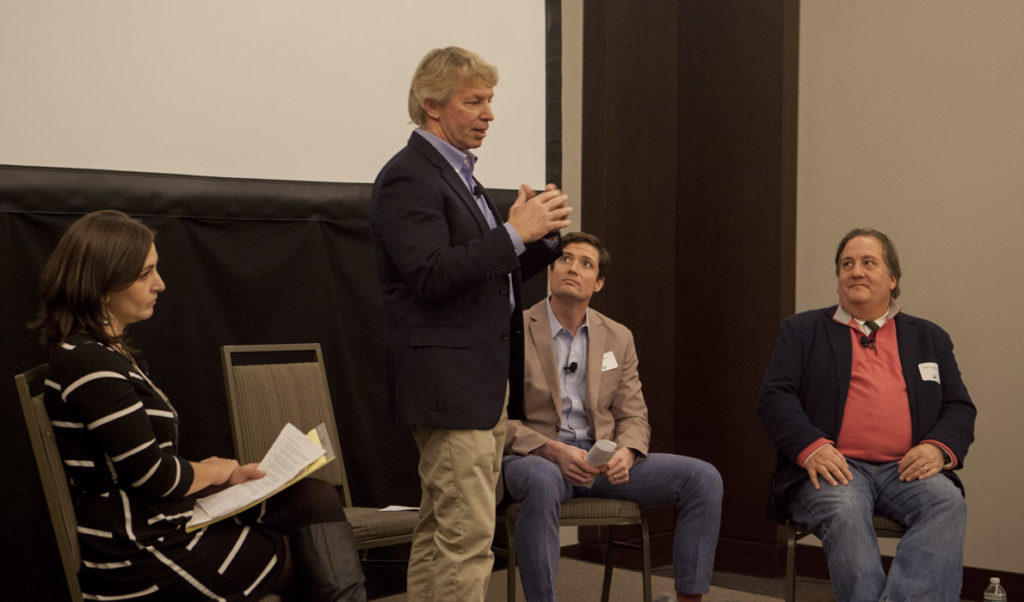 JB Turner of Belfast's Front Street Shipyard speaks at the Island Institute's Waypoints Forum in Portland on Jan. 19. At left is the Island Instiute's Briana Warner. At far right is Mark Ouellette of Axiom Technologies